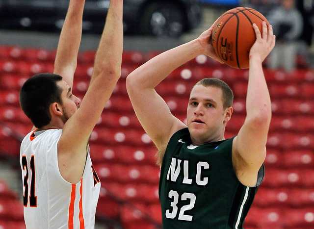 Wisconsin Lutheran forward Brett Lubbe (32) looks to pass the ball against Wartburg's Dan Van Groningen during a division III college basketball game at the South Point Arena on Tuesday, Dec. 30,  ...