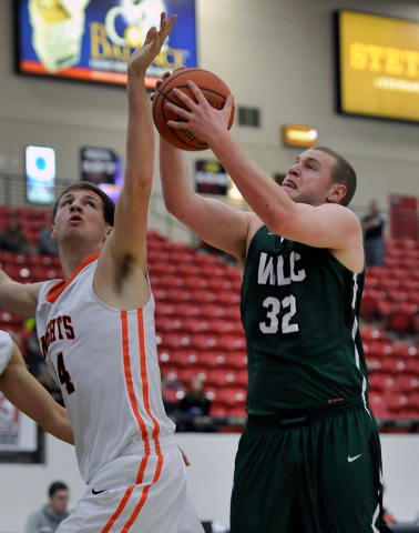 Wisconsin Lutheran forward Brett Lubbe (32) grabs a rebound against Wartburg's Ty Putchio during a division III college basketball game at the South Point Arena on Tuesday, Dec. 30, 2014, in Las V ...