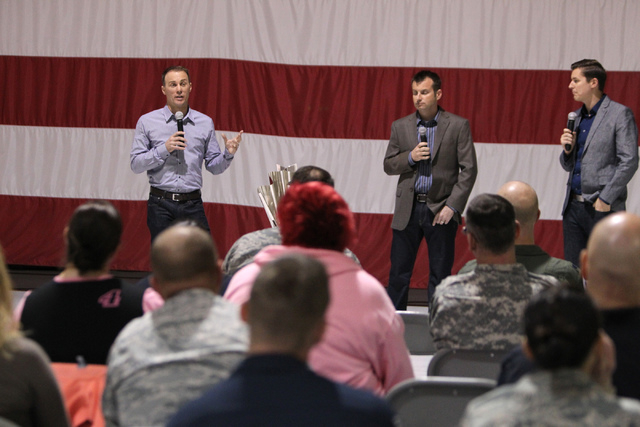 NASCAR driver Kevin Harvick, from left, speaks during a presentation with crew chief Rodney Childers, and reporter Alan Cavanna, for airmen and family members at the Nellis Air Force Base in Las V ...