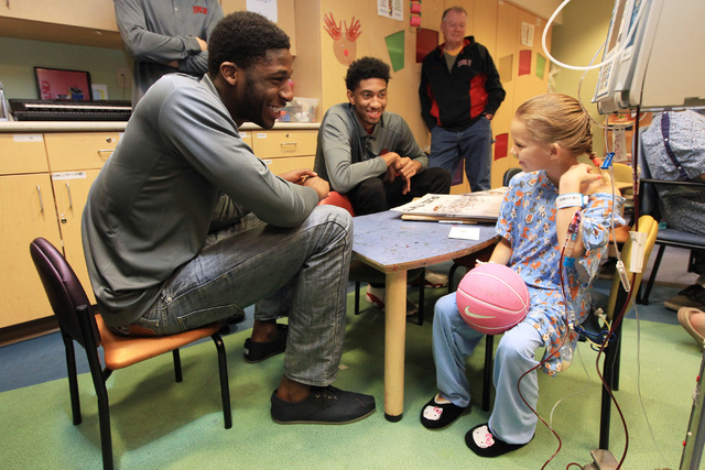 UNLV forwards Goodluck Okonoboh and Christian Wood talk with Tristen Kersey during a visit of the Rebels to Sunrise Children's Hospital Thursday, Dec. 18, 2014. (Sam Morris/Las Vegas Review-Journal)