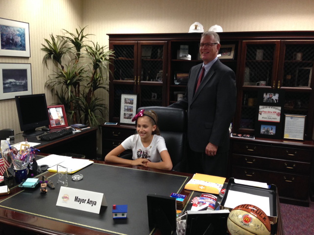Anya Siegel with Henderson Mayor Andy Hafen in his office after she won an essay contest by writing about what she'd do if she were mayor. (Photo courtesy Amanda Parson)