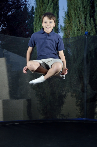 Bryce Revnew is shown at play on a trampoline at his home near South Eastern Avenue and Sunridge Heights Parkway in Henderson on Friday, Dec. 19, 2014. He was one of five winners of a fifth-grade  ...