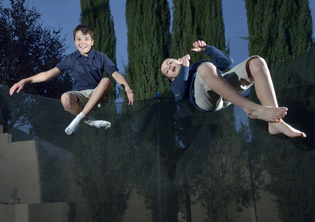 Bryce Revnew, left, and his brother Jack are shown at play on a trampoline in their backyard near South Eastern Avenue and Sunridge Heights Parkway in Henderson on Friday, Dec. 19, 2014. Bryce was ...