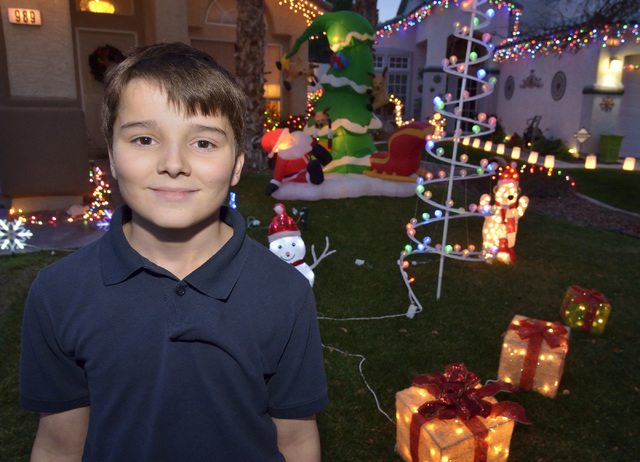 Bryce Revnew is shown at his home near South Eastern Avenue and Sunridge Heights Parkway in Henderson on Friday, Dec. 19, 2014. He was one of five winners of a fifth-grade essay contest in which s ...