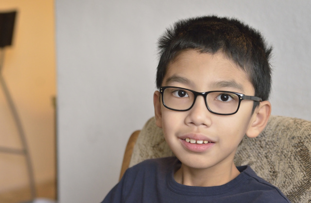 Andrew Derecho is shown at his home near South Eastern Avenue and Sunridge Heights Parkway in Henderson on Friday, Dec. 19, 2014. He was one of five winners of a fifth-grade essay contest in which ...