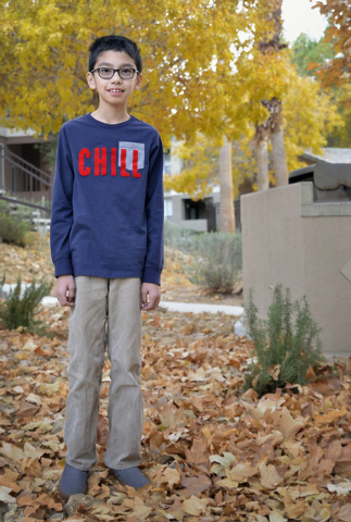 Andrew Derecho is shown near his home by South Eastern Avenue and Sunridge Heights Parkway in Henderson on Friday, Dec. 19, 2014. He was one of five winners of a fifth-grade essay contest in which ...