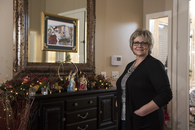 Pamela Taylor, who has been living with kidney stones for the past 15 years, poses for a portrait inside her home in Las Vegas on Monday Dec. 22, 2014. (Martin S. Fuentes/Las Vegas Review-Journal)