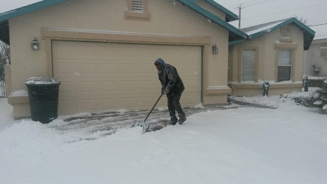 Tony Atwell of Kingman, Arizona, was prepared for Wednesday's storm as he was busy clearing snow from his driveway this morning. (Dave Hawkins/Las Vegas Review-Journal)