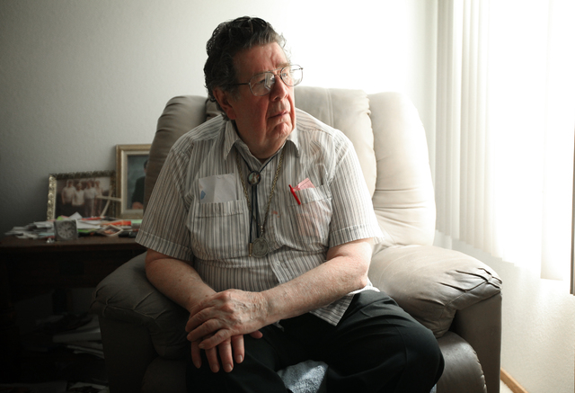 """Korean War veteran Charles """"Chuck"""" P. Mahoney sits in his Las Vegas home, Tuesday, April 10, 2012. Mahoney, who was wounded during the war was denied disability when he applied for benefits back t ..."""