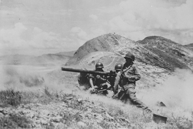 A 75mm recoilless rifle team from the 1st Cavalry Division keeps a bridge of fire going over Naktong River as they blast away at enemy positions in Korea, Sept. 5, 1950.  (AP Photo)