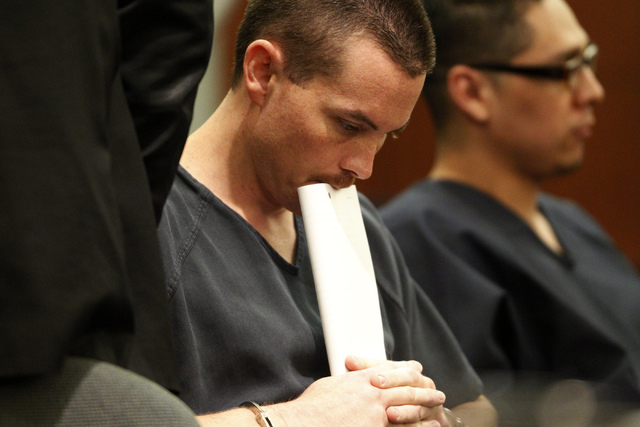 Kyle Kuhn, 31, waits in custody for his arraignment at the Regional Justice Center in Las Vegas Thursday, Sept. 4, 2014. Kuhn pleaded not guilty to felony charges that include assault with a deadl ...