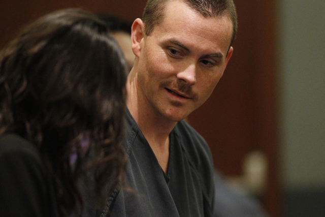 Kyle Kuhn, 31, speaks with his attorney during his arraignment at the Regional Justice Center in Las Vegas Thursday, Sept. 4, 2014. Kuhn pleaded not guilty to felony charges that include assault w ...