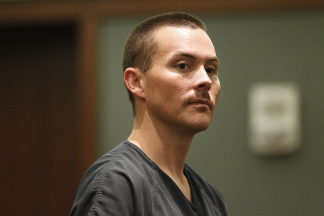 Kyle Kuhn, 31, stands for his arraignment at the Regional Justice Center in Las Vegas Thursday, Sept. 4, 2014. Kuhn pleaded not guilty to felony charges that include assault with a deadly weapon a ...