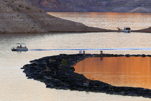 A pontoon boat makes its way past the Las Vegas Boat Harbor at Lake Mead, Oct. 6, 2014. The Southern Nevada Water Authority board members voted Wednesday, Dec. 10, to build a new $650 million pump ...