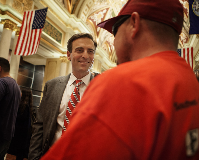 Nevada Attorney General-elect Adam Laxalt talks to wounded warrior Frankie Gomez during the Salute our Troops welcome ceremony at The Venetian on Wednesday, Dec. 03, 2014. (Jeff Scheid/Las Vegas R ...