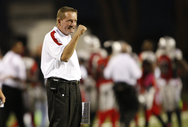 Locos head coach Jim Fassel celebrates after his team scored a touchdown against the Omaha Nighthawks during their game at Sam Boyd Stadium in Las Vegas Saturday, Oct. 8, 2011. (John Locher/Las Ve ...
