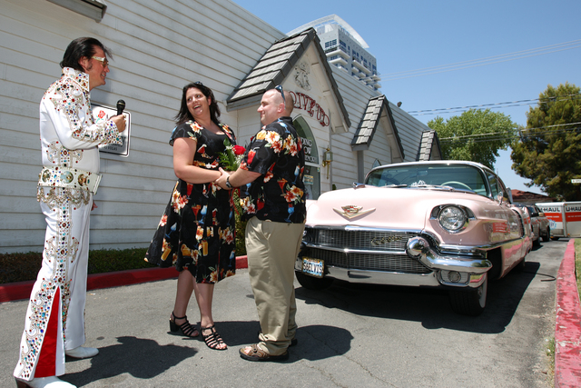 Elvis impersonator Eddie Powers, left, performs a wedding ceremony for Shawna Swanson and Robert Shirk on what they considered a lucky day at A Special Memory Wedding Chapel Saturday, July 7, 2007 ...