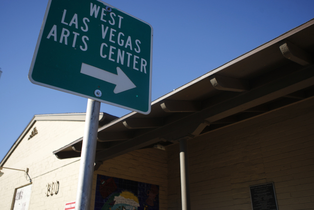 A sign pointing to the West Las Vegas Arts Center is seen in front of the Westside Grammar School, 330 W. Washington Ave., in Las Vegas Tuesday, Dec. 23, 2014. Las Vegas leaders have secured finan ...