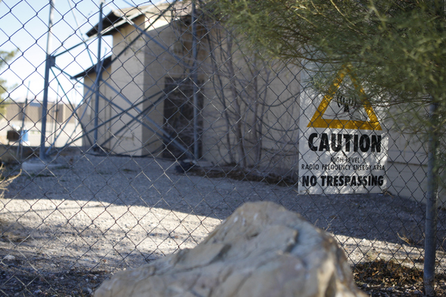 A caution sign is seen on a fence along the Westside Grammar School, 330 W. Washington Ave., in Las Vegas Tuesday, Dec. 23, 2014. Las Vegas leaders have secured financing for a long-planned $15 mi ...