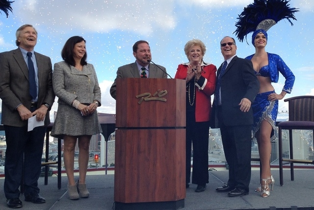 Master of ceremonies Andy Kaye of Lotus Broadcasting stands at the podium as Las Vegas Events president Pat Christenson, left, LVCVA's Cathy Tull, Las Vegas Mayor Carolyn Goodman and Phil Grucci,  ...