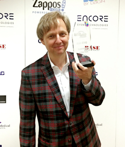 Comedy-Magician Mac King holding the Entertainer of the Year Award at the Rio All-Suites Hotel and Casino on Friday, Nov. 21, 2014.