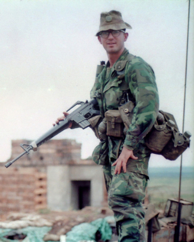 U.S. Marine Cpl. Steve Lowery, 21, poses in a portrait while serving as Recon Team Leader in Vietnam, September 1967. Note:  Lowery had been making a visual reconnaissance of patrol insertion poin ...