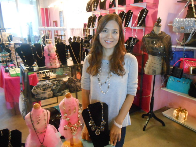 Grace Kim pauses Oct. 28, 2014, in her new store, Good Luck Accessories, inside the Market LV at Tivoli Village. The mini shopping center got a facelift at its entrance to help Tivoli shoppers dis ...