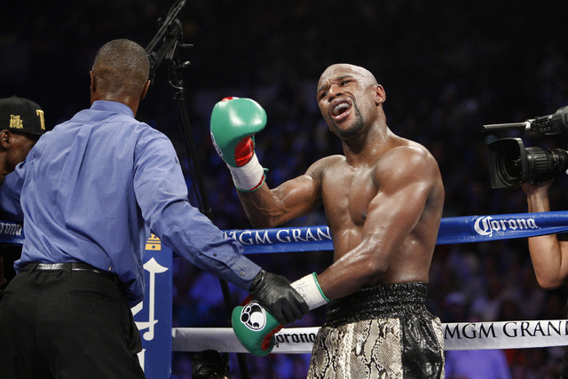 Floyd Mayweather Jr. reacts to an incident in the eighth round of his fight with Marcos Maidana during their WBC/WBA welterweight title fight at the MGM Grand Garden Arena in Las Vegas on Saturday ...