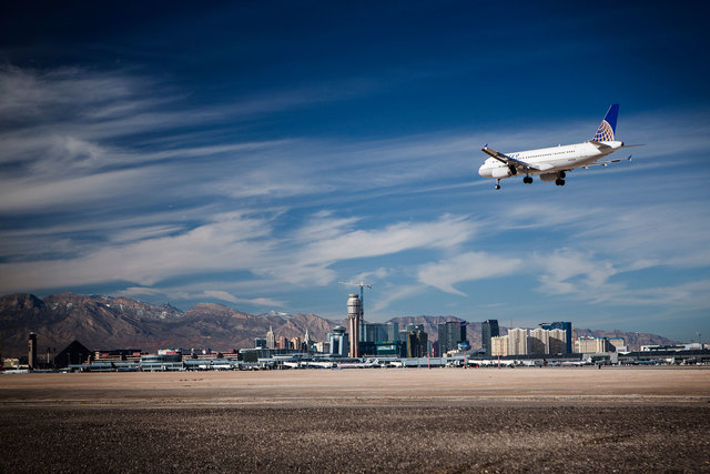 A United Airlines jet prepares to land at McCarran International Airport in 2013. Flights to and from McCarran were running smoothly Wednesday morning, Nov. 26, 2014, as holiday travel picks up, b ...