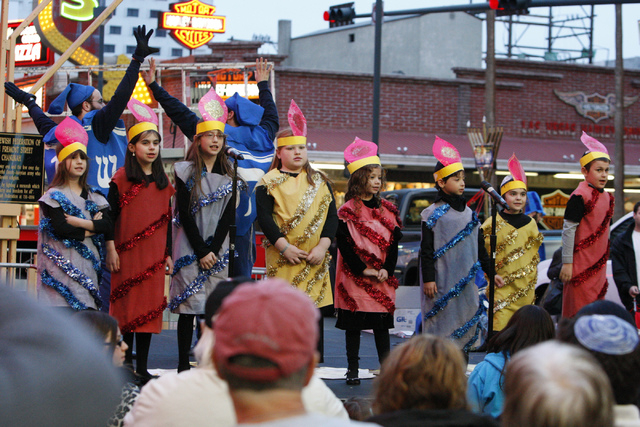 Children with the Desert Torah Academy choir sing during the annual Grand Menorah Lighting Ceremony at Fremont Street Experience in Las Vegas Tuesday, Dec. 16, 2014. The event was hosted by the Ch ...