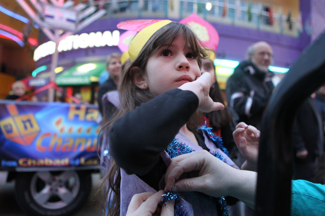 Adeena Sudranski, 6, gets ready for her performance with the Desert Torah Academy choir during the annual Grand Menorah Lighting Ceremony at Fremont Street Experience in Las Vegas Tuesday, Dec. 16 ...