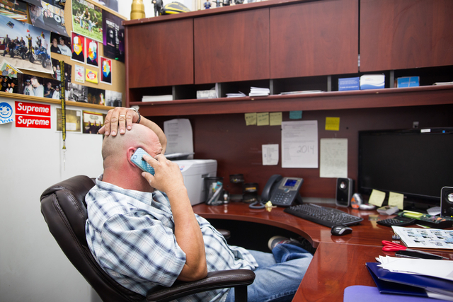 """Rick Harrison of the reality TV show """"Pawn Stars"""" takes a phone call at his office at Gold & Silver Pawn shop in downtown Las Vegas on Thursday, July 17, 2014. (Chase Stevens/Las Vegas R ..."""