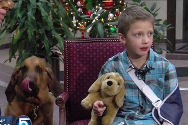 Kollin Bailey, 6, of Herriman, Utah, was rescued by police dog Copper, left, after Kollin fell into an open manhole near his home and became trapped underground for several hours on Friday, Dec. 5 ...