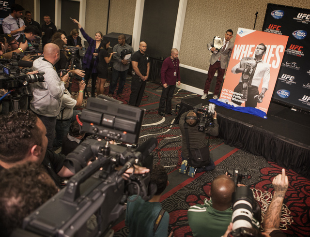 UFC Lightweight Champion Anthony Pettis stands besides oversized Wheaties box during Media Day at MGM Grand on Thursday, Dec. 03, 2014. Pettis is the first UFC boxer to be on cereal box. He will b ...