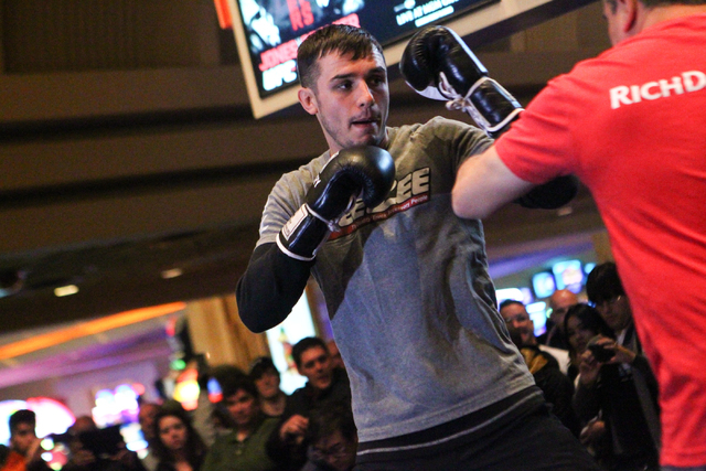 UFC fighter Myles Jury, left, works out with trainer Eric Del Fierro inside of the MGM Grand hotel-casino on Wednesday, Dec. 31, 2014. Jury is slated to face Donald Cerrone in UFC 182. (Chase Stev ...
