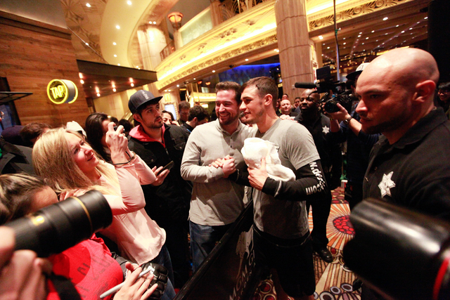 UFC fighter Myles Jury, center right, poses for photos with fans inside of the MGM Grand hotel-casino on Wednesday, Dec. 31, 2014. Jury is slated to face Donald Cerrone in UFC 182. (Chase Stevens/ ...