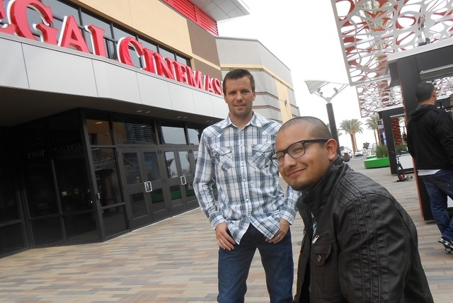 Joe Pena, seated, lead pastor of the new Relentless Church at Downtown Summerlin, and Brandon Martin, church coordinator, talk about church's message Dec. 12, 2014, outside Regal Downtown Summerli ...