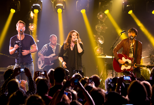 This May 8, 2013, file photo released by iHeartRadio shows members of the band Lady Antebellum, from left, Charles Kelley, Hillary Scott, and Dave Haywood during a performance in New York. (AP Pho ...