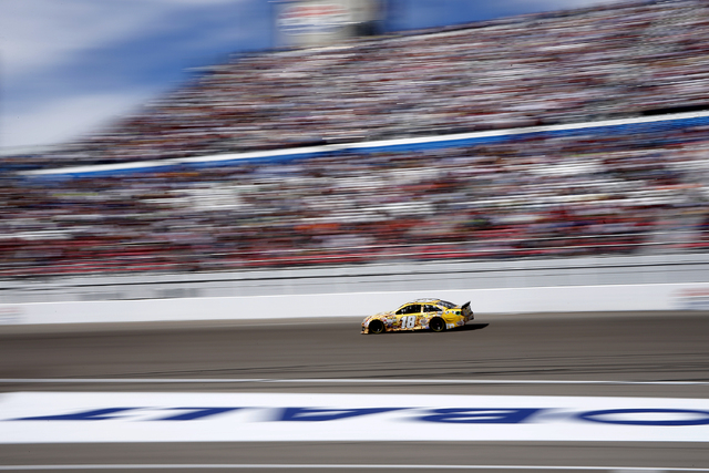Kyle Busch (18) drives out of turn four during the NASCAR Kobalt 400 at the Las Vegas Motor Speedway in Las Vegas Sunday, March 9, 2014. (John Locher/Las Vegas Review-Journal)