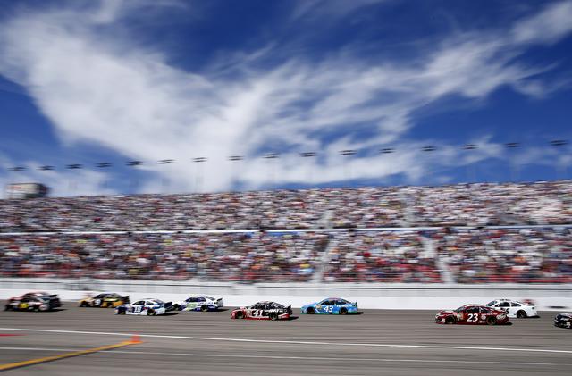 Cars race during the NASCAR Kobalt 400 at the Las Vegas Motor Speedway on Sunday. (John Locher/Las Vegas Review-Journal)