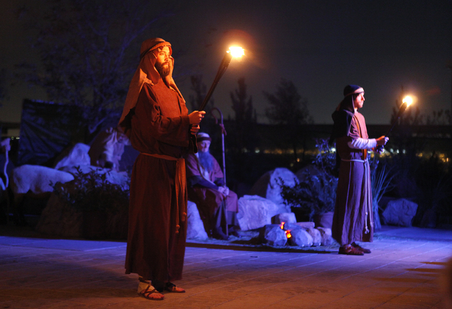 Volunteers perform in a Live Nativity at Opportunity Village, 6050 S. Buffalo Drive, Dec. 10, 2013. The Redrock Stake of The Church of Jesus Christ of Latter-day Saints plans to present this year' ...