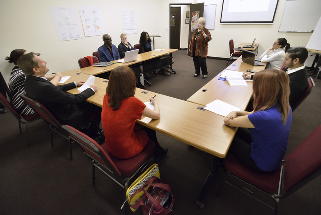 """Patti Shock, academic consultant at The International School of Hospitality, talks with students from the """"Conference Management and Event Planning"""" class at the school at 3614 Sunset Ro ..."""