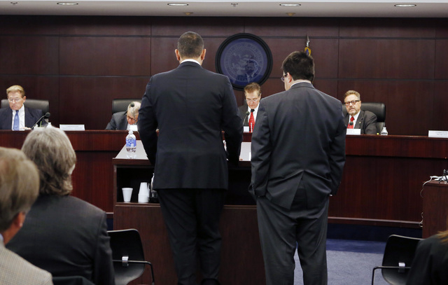 Sam Nazarian, CEO of SBE Entertainment, left, and his attorney Tony Cabot appear before the Nevada Gaming Commission during a hearing as Nazarian seeks a gambling license he needs on Thursday, Dec ...