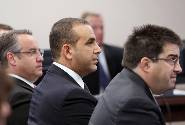 Sam Nazarian, CEO of SBE Entertainment, center, and his attorney Tony Cabot, right and Sen. Mark Lipparelli, left, are seen befor Nazarian appeared before the Nevada Gaming Commission during a hea ...