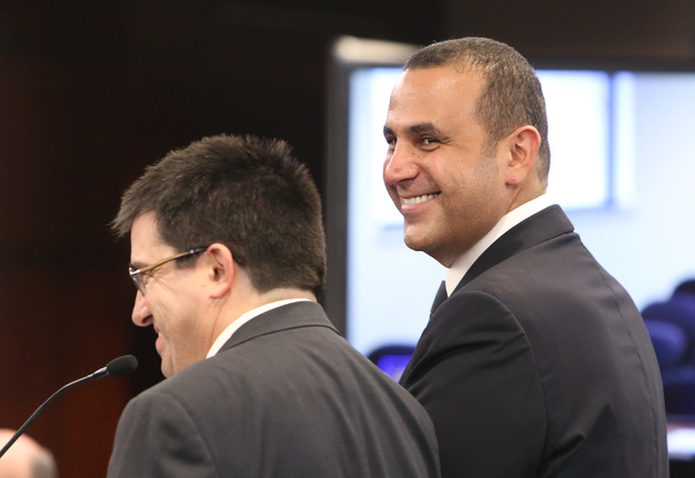 Sam Nazarian, CEO of SBE Entertainment, right, and his attorney Tony Cabotsmile as they appear before the Nevada Gaming Commission during a hearing as Nazarian seeks a gambling license he needs on ...