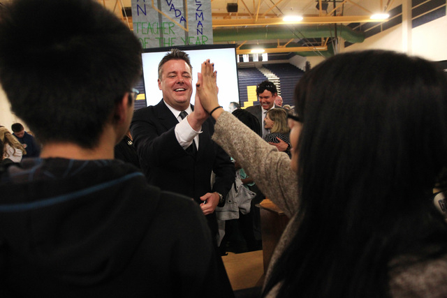 Spring Valley High School teacher Ian Salzman gets a high five from a student after being named Nevada teacher of the year Friday, Dec. 19, 2014. (Sam Morris/Las Vegas Review-Journal)