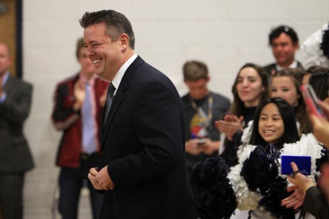 Spring Valley High School teacher Ian Salzman heads to the dais after being named Nevada teacher of the year Friday, Dec. 19, 2014. (Sam Morris/Las Vegas Review-Journal)