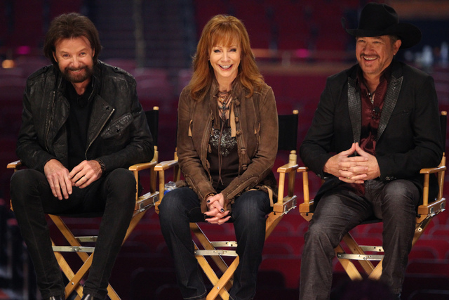 Singer Ronnie Dunn, from left, TV actress Reba McEntire, and singer Kix Brooks, speak after being announced the newest resident headliners at The Colosseum during a press conference at The Colosse ...
