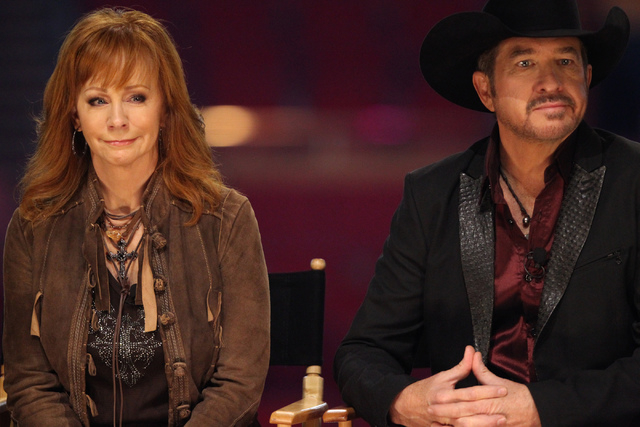 TV actress Reba McEntire, left, and singer Kix Brooks, are interviewed after being announced the newest resident headliners at The Colosseum during a press conference at The Colosseum inside Caesa ...