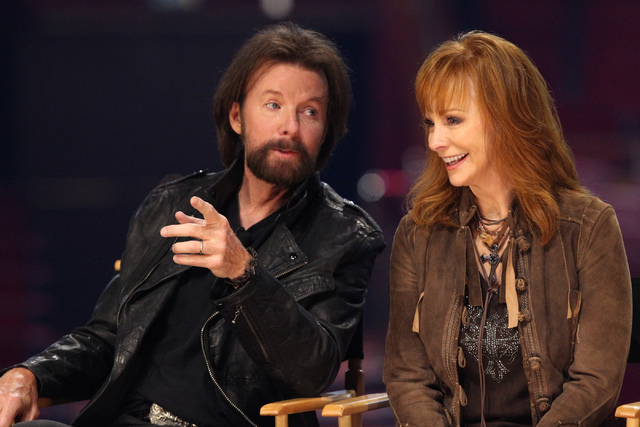 Country singer Ronnie Dunn, left, and TV actress Reba McEntire, speak after being announced the newest resident headliners at The Colosseum during a press conference at The Colosseum inside Caesar ...